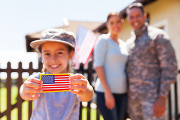 little girl holding american flag badge