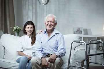 Elderly man with a community nurse