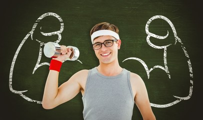 Composite image of geeky hipster posing with dumbbell