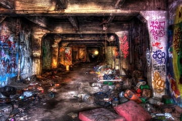 Underground scary tunnel covered with junk and graffiti Wall mural