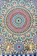 Moroccan style water tap with detailed mosaic