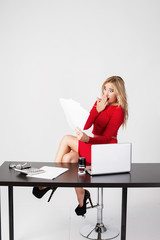 Young business woman secretary shocked looking at a piece of paper document. Accounting Report,  annual document