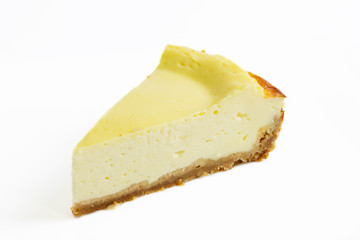 Slice of cheesecake isolated