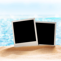 photo frames on the sea sand