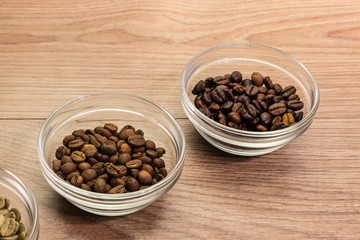 Coffee beans of different roasting in glass bowl