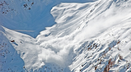 Snow avalanche in the mountains in winter