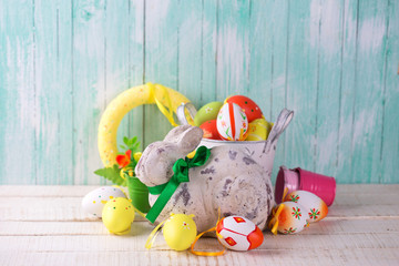 Decorative Easter rabbit, colorful eggs
