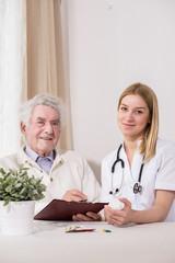 Ill man with private nurse