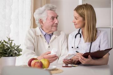 Ill elderly man with medicines