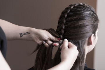 Haidresser doing plait