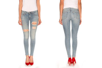 female legs in blue jeans and red shoes