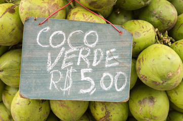 Sign advertising price of green drinking coconuts in Rio de Janeiro Brazil for five reals