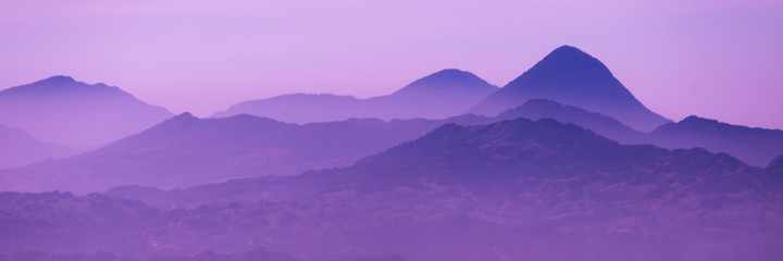 Skyscape of cold purple mountains with mist and fog close to Quetzaltenango
