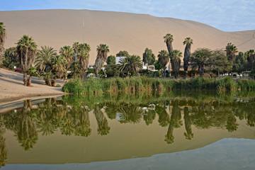 Lake and sand dunes near Huacachina, Ica region, Peru.