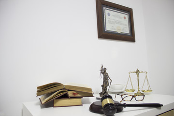 Law concept, statue, gavel, scale, diploma and books
