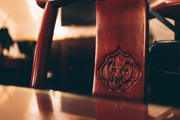 Wooden black brown chair at the table.