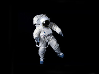 Astronaut floating against a black background. Fototapete