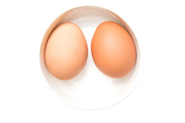 two eggs in a white bowl