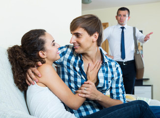Love triangle: husband, wife and lover at domestic interior