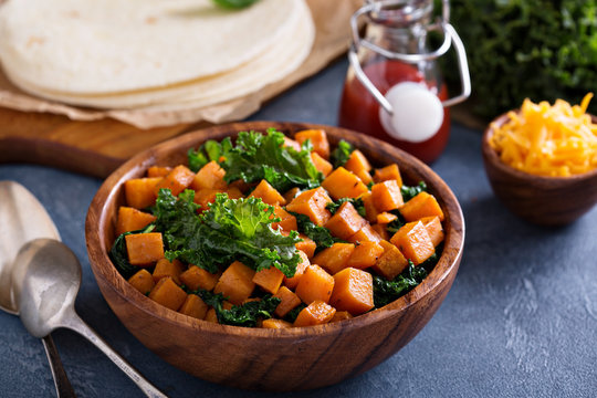 Making quesadillas with kale and sweet potato