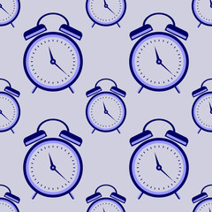 Seamless vector pattern. Symmetrical background with closeup blue alarm clocks on the blue background.