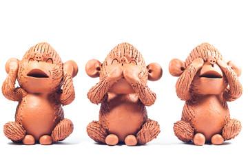 Close-up monkey clay dolls isolated on white background