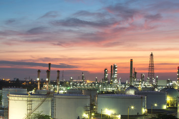 Oil refinery and oil thank in sunset background