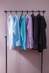 colored men's shirts that hang on hangers