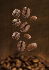 Closeup of coffee beans falling