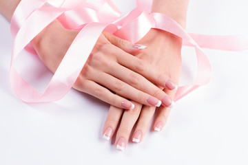 Fototapete - French manicure with pink ribbon.