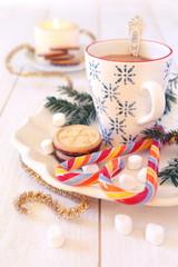 Cup of coffee milk and christmas sugar cookies