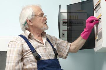 Man fixing electric light meter