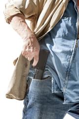 Man pulls a gun out of his pocket