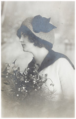 young woman with chrismas bouquet