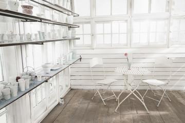 Porcelain vases on shelf in glass house, Bavaria, Germany