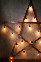 Decorative star with old lamps