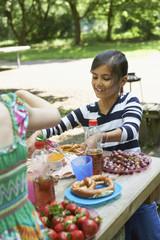 Girl eating food and smiling at picnic, Munich, Bavaria, Germany