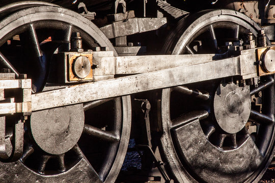 Detail of steam train engine wheels and engineering, transport and heavy industry