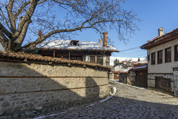 Street in old town and wooden house in Bansko,  Blagoevgrad region, Bulgaria