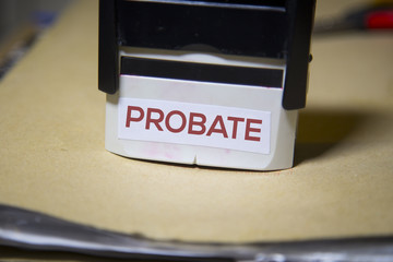 Probate stamp on a big folder of paperwork
