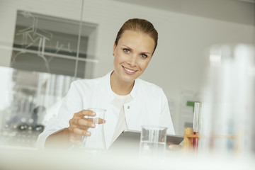 Portrait of smiling female scientist in lab