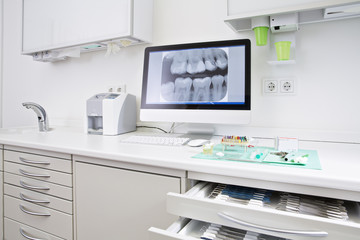 Drawer with dental instruments and x ray image of teeth
