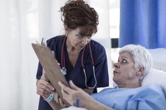 Doctor explaining patient advance directive