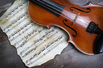 violin with music sheets