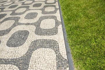 Ipanema Beach Rio de Janeiro Brazil sidewalk pattern with green grass lawn border