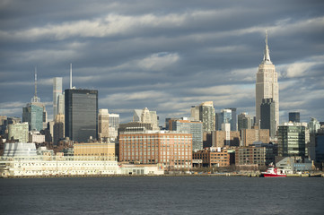 Scenic landscape view of the Midtown Manhattan skyline of New York City from the Hudson River on the New Jersey side