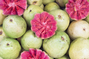 Fresh cut pink guava goiaba at Brazilian farmers market at General Osorio Plaza, Ipanema, Rio de Janeiro, Brazil