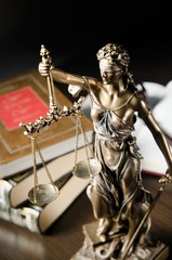 Law concept with Themis and books in background