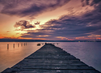 Stunning lake sunset with wooden pier