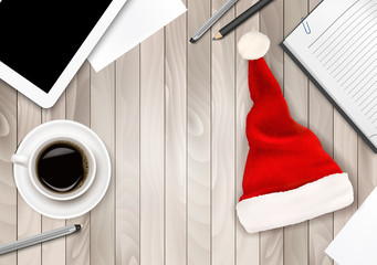 Office Background with Santa Hat, Tablet and Office Supplies. Bu